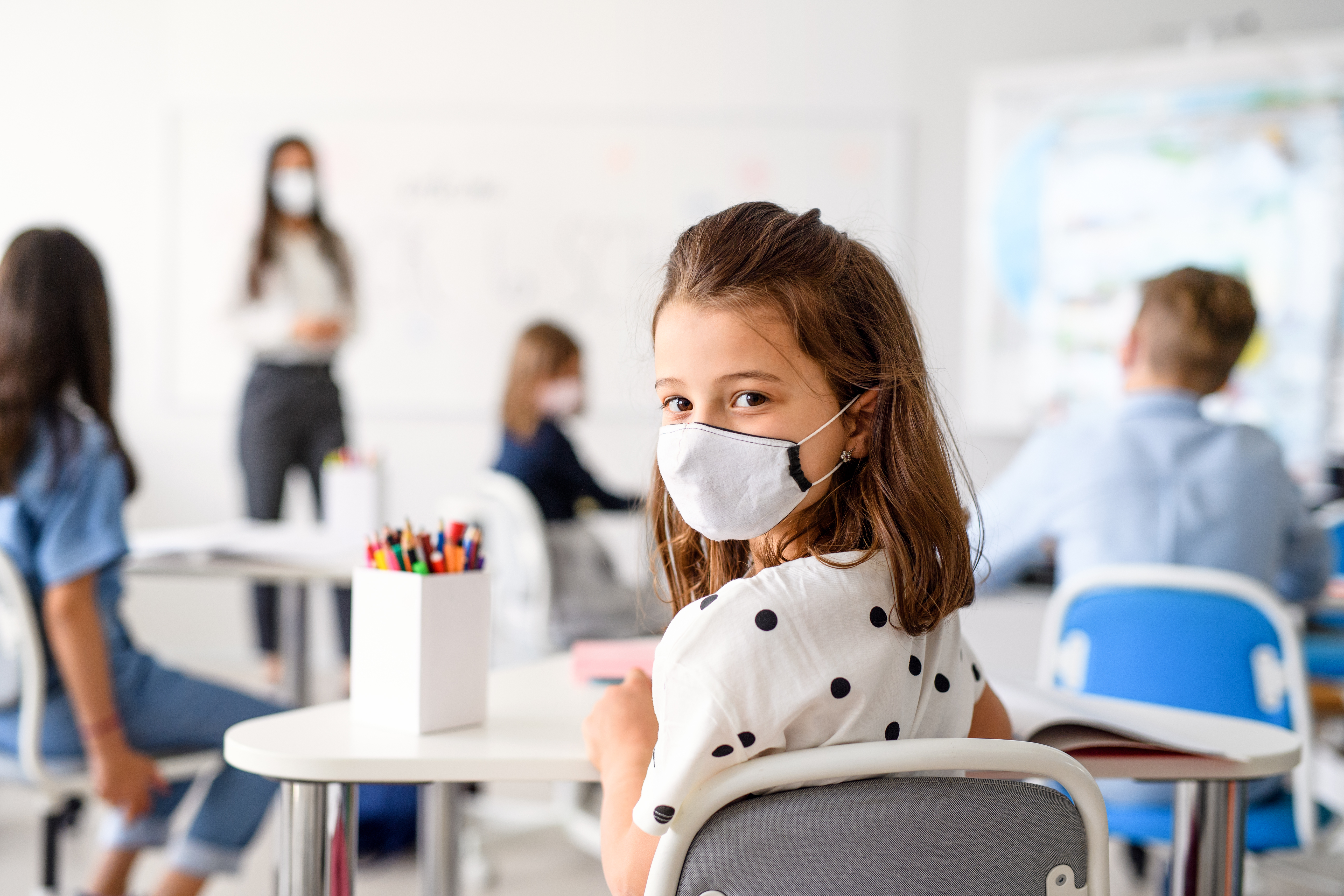 Child,With,Face,Mask,Back,At,School,After,Covid-19,Quarantine